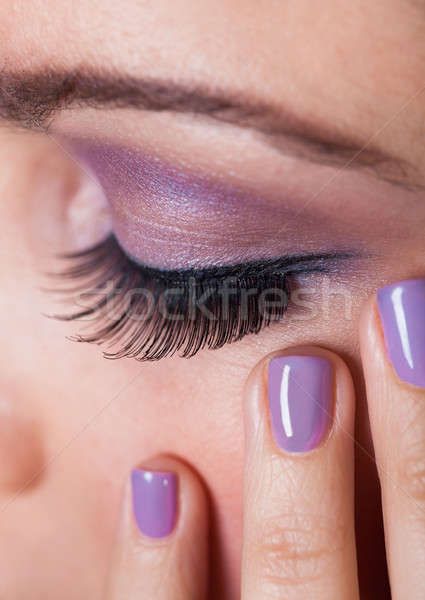 Close-up Of Woman's Eye With Purple Eyeshadow Stock photo © AndreyPopov