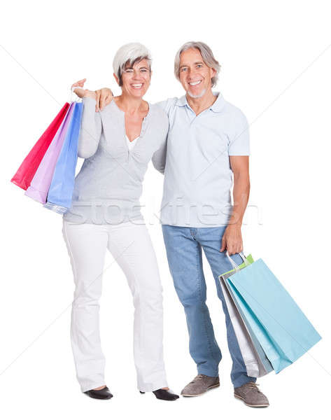 Happy senior shopaholics Stock photo © AndreyPopov