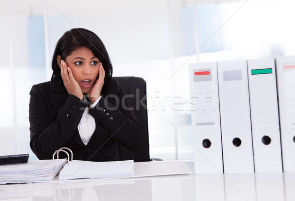 Shocked Businesswoman Looking At Folder Stock photo © AndreyPopov