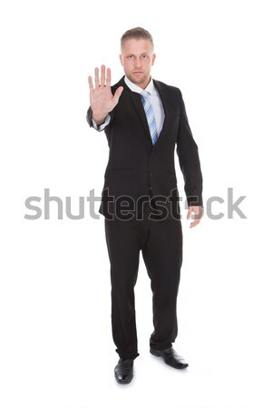 Businessman holding up his hand in a stop gesture Stock photo © AndreyPopov