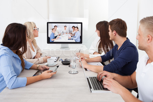 Business Team Attending Video Conference Stock photo © AndreyPopov