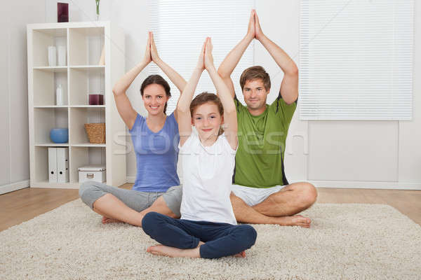 Family Practicing Yoga On Rug Stock photo © AndreyPopov
