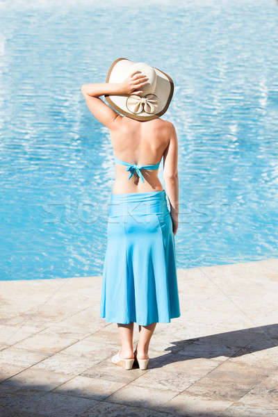Happy Woman Standing At Poolside Stock photo © AndreyPopov