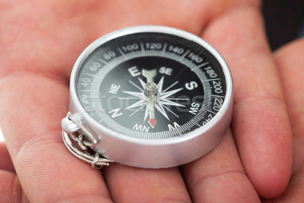 Man's Hands Holding Compass Stock photo © AndreyPopov