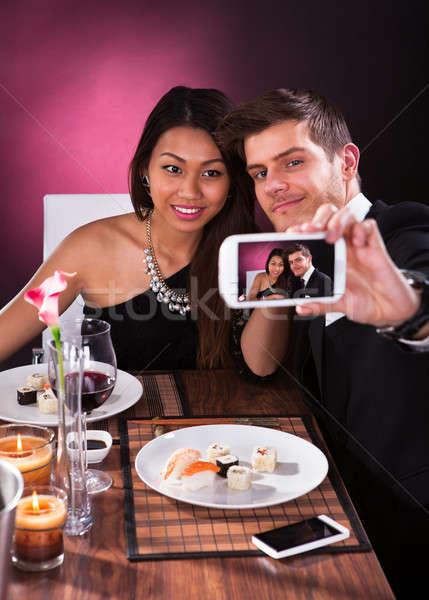 Couple Taking Self Portrait At Restaurant Stock photo © AndreyPopov