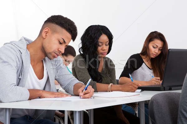 Stock photo: Students Writing At Desk