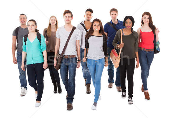 Confident University Students Walking Over White Background Stock photo © AndreyPopov