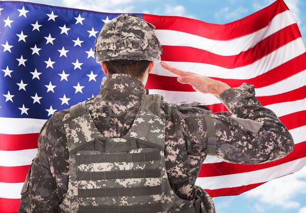 Soldato bandiera americana vista posteriore cielo persona paese Foto d'archivio © AndreyPopov