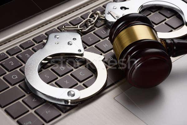 молоток наручники ноутбука бизнеса древесины Сток-фото © AndreyPopov