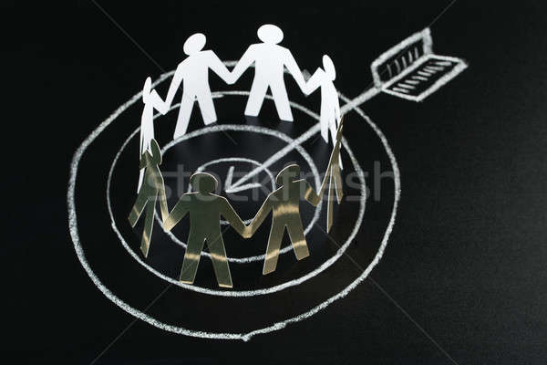 White Paper Cut-out Figures Over Dart And Arrow Stock photo © AndreyPopov
