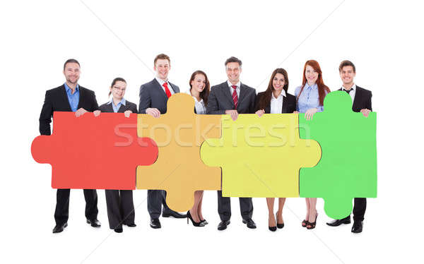 Confident Businesspeople Joining Jigsaw Puzzle Pieces Stock photo © AndreyPopov