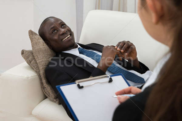 Psychiatrist Making Notes In Front Of Patient Stock photo © AndreyPopov