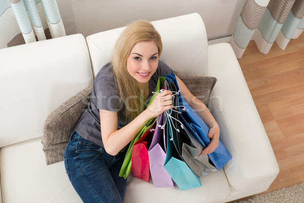 Woman With Shopping Bags On Couch Stock photo © AndreyPopov