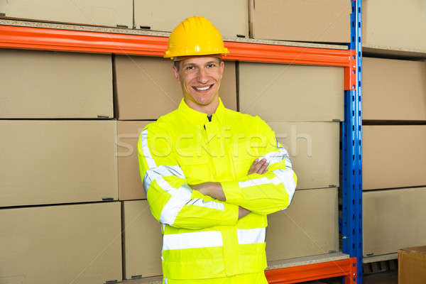 Happy Male Warehouse Worker With Arms Crossed Stock photo © AndreyPopov