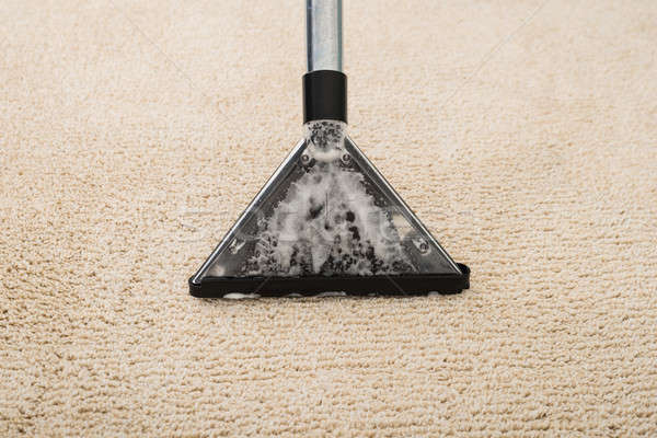Vacuum Cleaner Over Carpet With Foam Stock photo © AndreyPopov