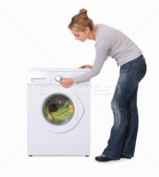 Сток-фото: женщину · стиральная · машина · белый · вид · сбоку