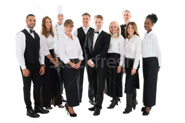 Portrait Of Confident Restaurant Staff Standing In Row Stock photo © AndreyPopov