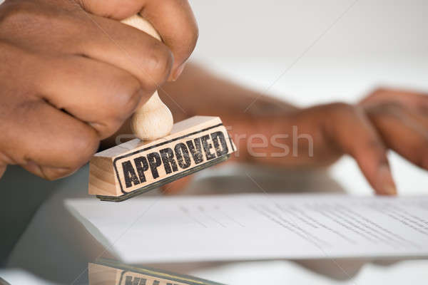 Person's Hand Stamping On Contract Form Stock photo © AndreyPopov