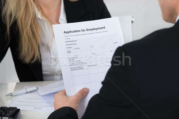Candidate Holding Application Form In Front Of Interviewer Stock photo © AndreyPopov