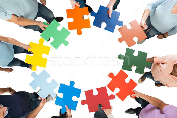 Creative Business Team Holding Colorful Jigsaw Pieces Stock photo © AndreyPopov