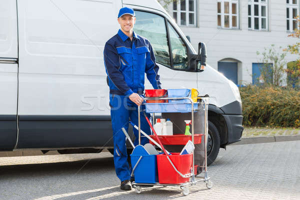 Happy Janitor Standing With Cleaning Equipment Stock photo © AndreyPopov