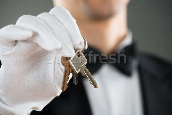Midsection Of Waiter Holding Keys Stock photo © AndreyPopov
