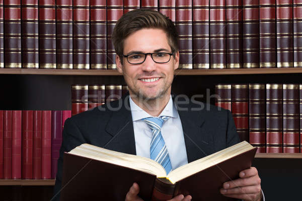 Advocate Reading Book At Courtroom Stock photo © AndreyPopov