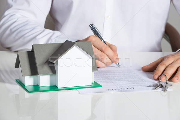 Businessman Signing House Contract Stock photo © AndreyPopov