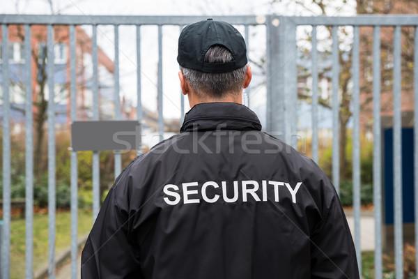 охранник Постоянный ворот вид сзади зрелый человека Сток-фото © AndreyPopov