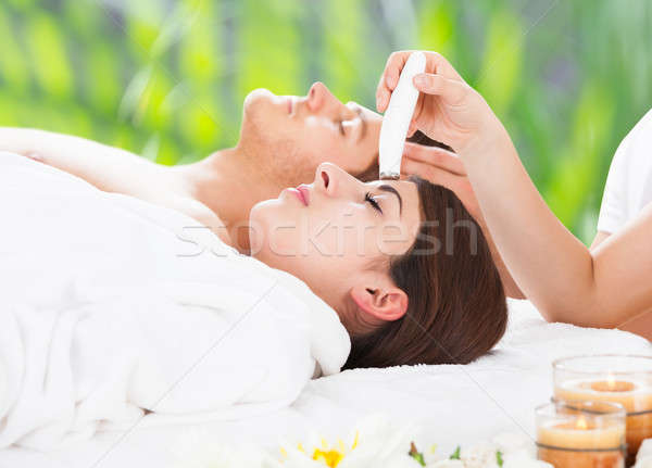 Relaxed Couple Undergoing Therapies At Spa Stock photo © AndreyPopov