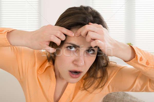 Woman Squeezing Pimple Stock photo © AndreyPopov
