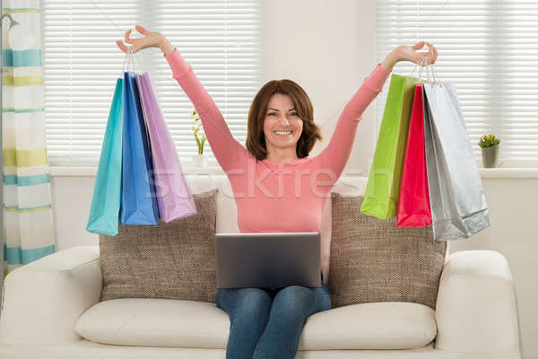 Woman Holding Multi-colored Shopping Bags Stock photo © AndreyPopov
