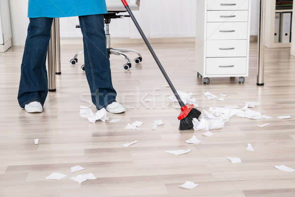 Close-up Of Janitor Sweeping Hardwood Floor Stock photo © AndreyPopov