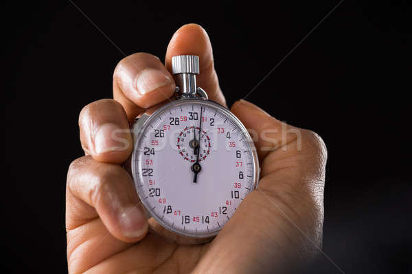 Person Hand Holding Stop Watch Stock photo © AndreyPopov