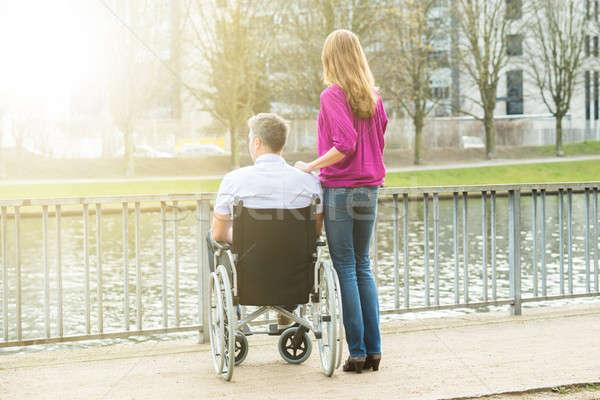 женщину инвалидов муж коляске вид сзади глядя Сток-фото © AndreyPopov