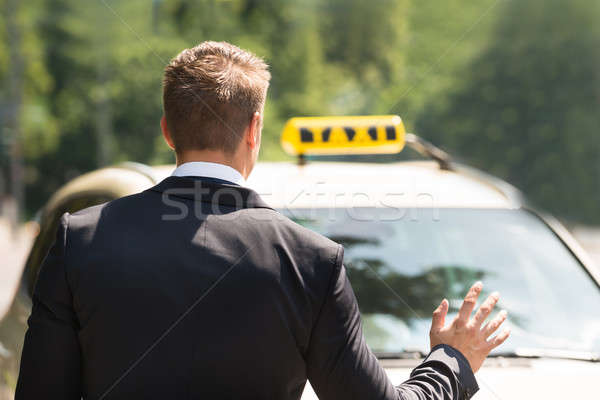 Businessman Calling Taxi Stock photo © AndreyPopov