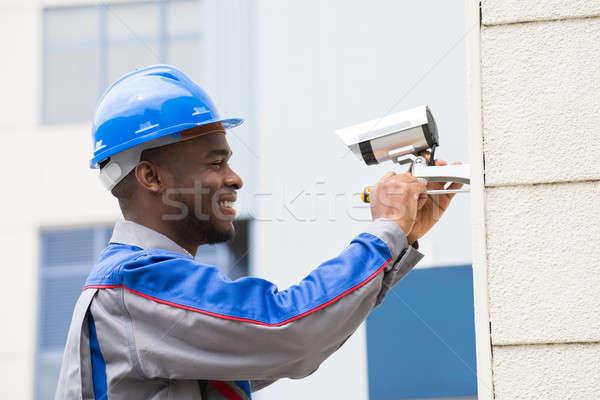 Férfi technikus javít kamera fiatal boldog Stock fotó © AndreyPopov