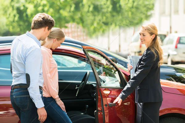 Dealer Opening Car Door For Customer Stock photo © AndreyPopov
