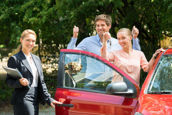 Couple Showing Key Of Newly Purchased Car Stock photo © AndreyPopov