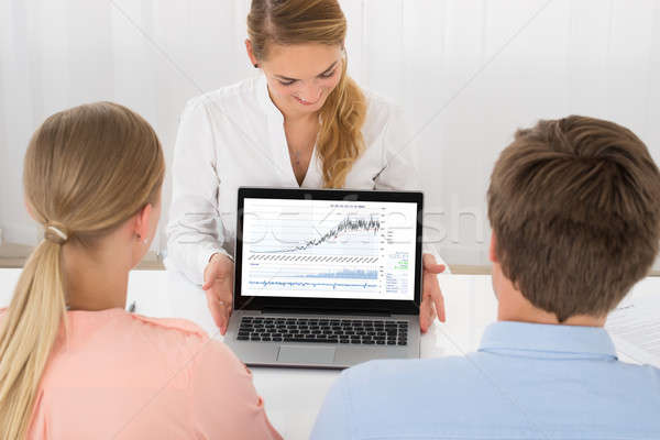 Consultant Showing Graph To Couple Stock photo © AndreyPopov