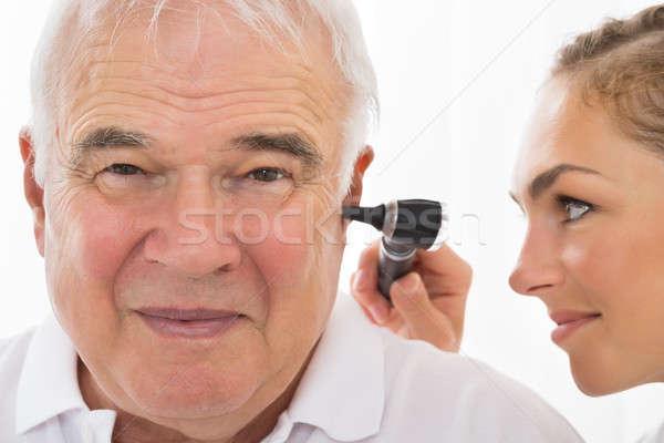 Female Doctor Examining Patient's Ear Stock photo © AndreyPopov