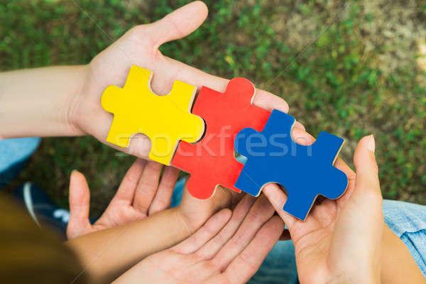 Mãos peças três Foto stock © AndreyPopov