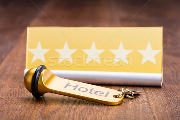 Hotel Key With Five Star Shape Card Stock photo © AndreyPopov
