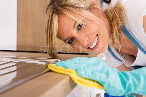 Close-up Of Woman Cleaning Kitchen Worktop Stock photo © AndreyPopov