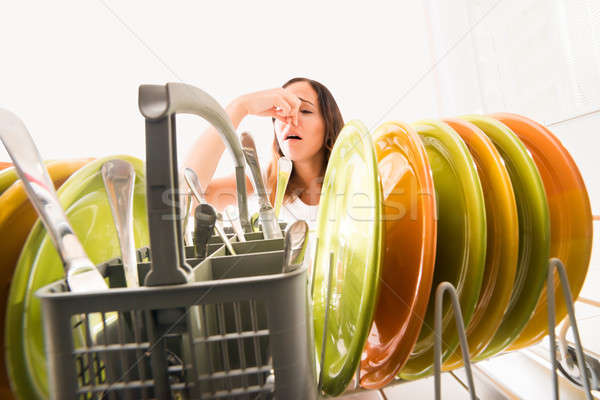 Woman Noticed Smell Coming From Dishwasher Stock photo © AndreyPopov