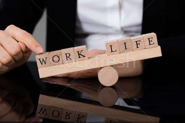 An Imbalance Between Life And Work On Seesaw Stock photo © AndreyPopov