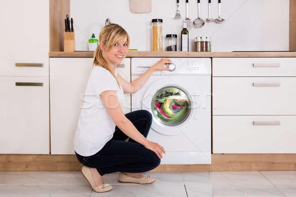женщину очистки одежды стиральная машина Сток-фото © AndreyPopov