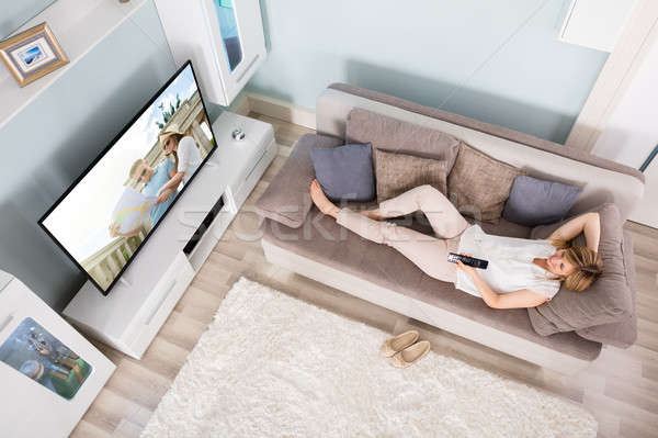 High Angle View Of Woman Watching Television Stock photo © AndreyPopov