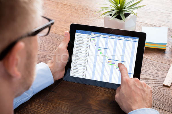Businessman Working On Gantt Chart On Digital Tablet Stock photo © AndreyPopov