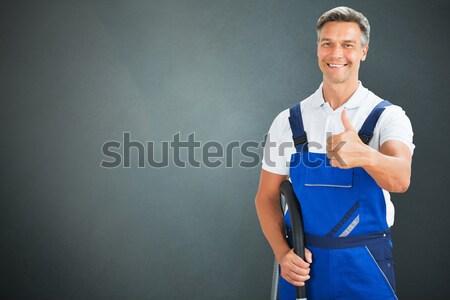 Mosolyog férfi gondnok portré szürke hátterek Stock fotó © AndreyPopov